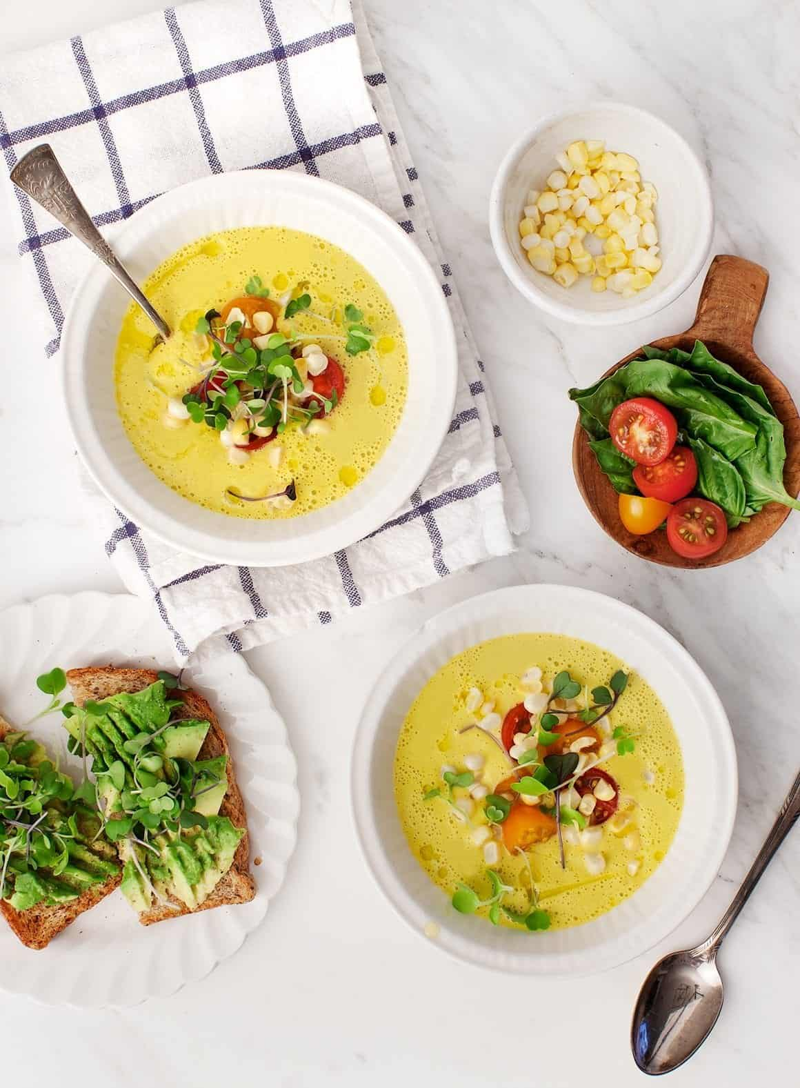 Sweet Corn Gazpacho in bowls with spoons